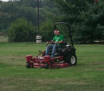 photo of student on commercial mower as a part of his sae