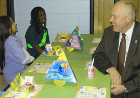 Photo of Secretary Kuperus eating breakfast with Perth Amboy students - Click to enlarge