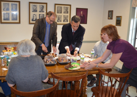 Photo of Secretary Fisher serving lunch at Family Promise - Click to enlarge