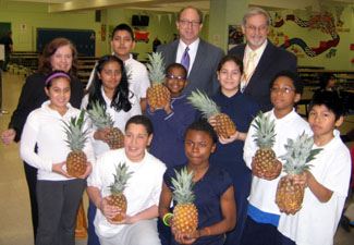 Photo of Barbara Martin, Secretary Fisher, School 11 Principal Chester Kominski and students