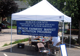 Photo of Senior Farmers Market Nutrition Program Booth - Click to enlarge
