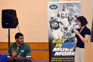 Photo of Jets lineback Aaron Maybin and NJDA's Arleen Ramos-Szatmary