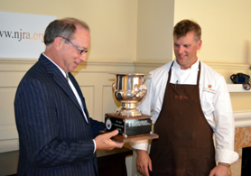 Photo of Secretary Fisher and Chris Albrecht with the trophy - Click to enlarge
