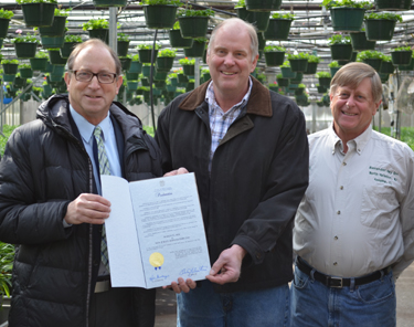 Photo of Secretary Fisher and Bob and Bill Eelman from Alexander Hay Greenhouses