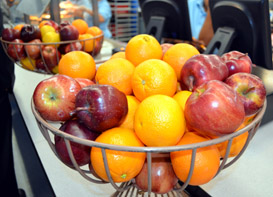 Photo of apples and oranges on the school lunch line - Click to enlarge
