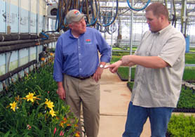 Photo of Secretary Kuperus and Bob Blew looking at Day lilies - Click to enlarge