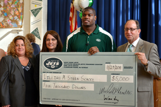 Photo of check presentation to Lillian Steen School