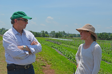 Photo of Secretary Fisher and Jess Niederer at Chickadee Creek farm
