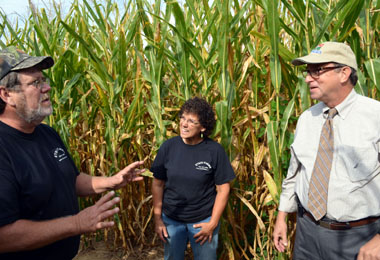 Photo of Jim and Caroline Etsch with Secretary Fisher in their corn maze