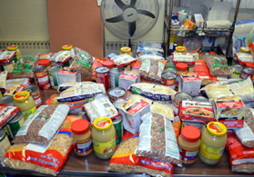 Photo of food being readied for distribution at a food pantry - Click to enlarge