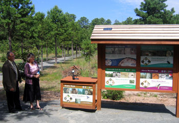 Photo of Carl Schulze and Lynn Fleming unveiling the Forest Pest Kiosk