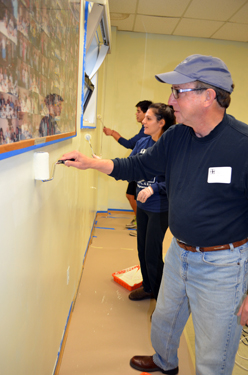 Photo of Secretary Fisher painting at the Garfield Senior Center