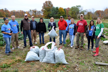 Photo of Secretary Fisher, Assemblywoman Nancy Pinkin and volunteers at gleaning