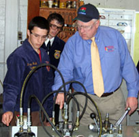 Photo of Secretary Kuperus during hydraulics demonstration
