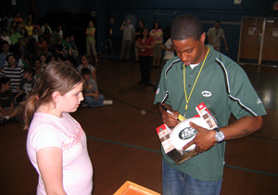Photo of Chris Davis with a Rittenberg Middle School student prize winner - Click to enlarge