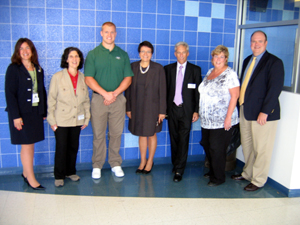 Photo of the Jets Mulligan with officials at Hightstown High School