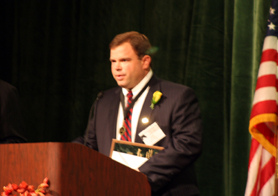 Photo of John Melick accepting his National OYF Award - Click to enlarge