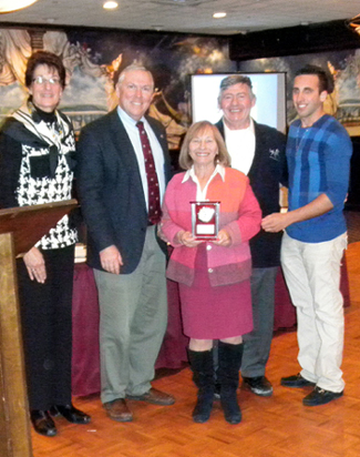 Photo of Landy Family receiving their award