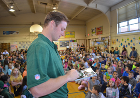 Photo of Jets Quarterback Greg McElroy signing a program in Brick Township - Click to enlarge