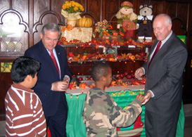 Photo of Senator Menendez and Secretary Kuperus handing out apples - Click to enlarge