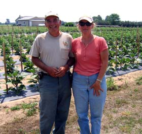 Photo of Dave and Elaine Monteleone on their farm