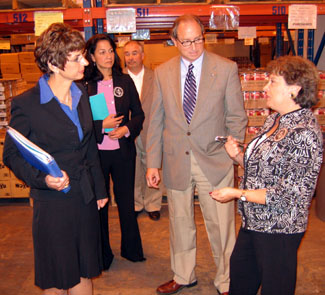 Photo of Commissioners Grifa and Velez and Secretary Fisher on a tour of the Mercer Street Friends food bank
