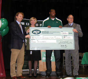 Photo of the Jets awarding check to Netcong Elementary School