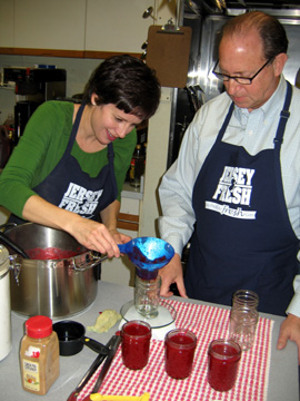 Photo of Nina Rizzo and Secretary Fisher canning cranberry sauce