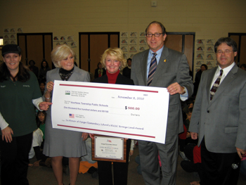 Photo of check presentation to Osage Elementary School
