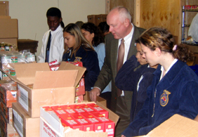 Photo of Secretary Kuperus and FFA members at the Salvation Army in Plainfield