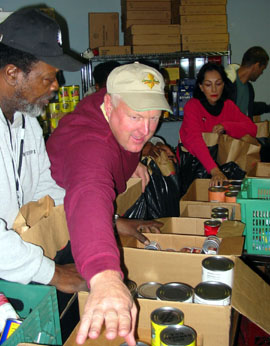 SECRETARY ASSEMBLES AND DISTRIBUTES THANKSGIVING FOOD BASKETS