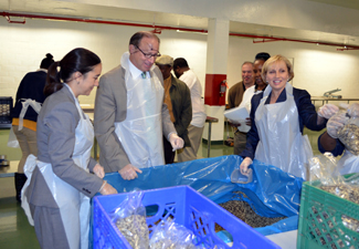 Photo of Commissioner O'Dowd, Secretary Fisher and Acting Governor Guadagno packing rice