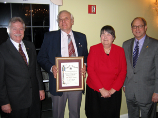 Photo of Scott Ellis, Peter Staats, Carol Staats and Secretary Fisher