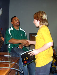 Photo of Chansi Stuckey handing out a prize