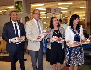Photo of Secretary Fisher and Diana Limbacher with school superintendent Silvia Abbato and school principal Rudy Baez