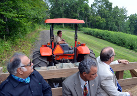 Photo of officials on hayride at Wightmans Farm - Click to enlarge