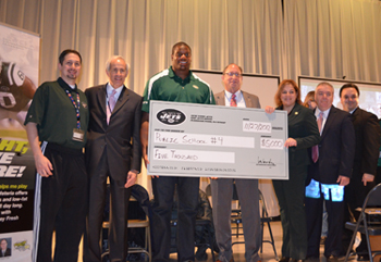 Photo of West New York PS #4 accepting grand prize in the Eat Right, Move More program