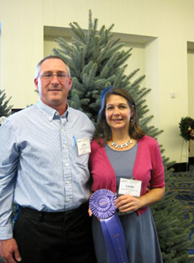 Photo of John and Leslie Wyckoff and their winning Christmas Tree