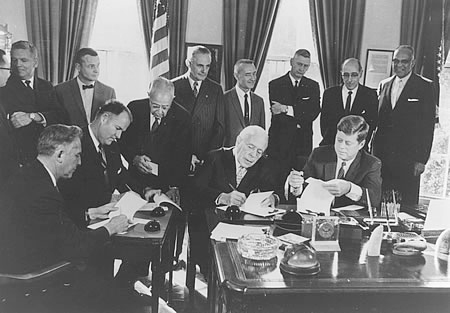 President Kennedy and the basin state governors signing ceremonial compact documents at the White House in 1961.