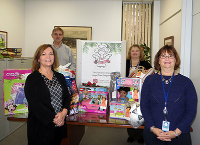 DRBC's Finance/Administration staff, who helped organize the gift drive, pose with the donated toys. Photo by DRBC.