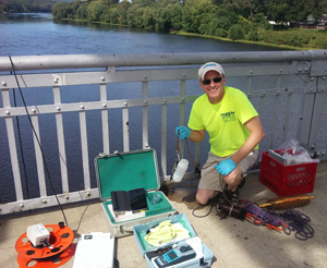 DRBC's Dr. Ron MacGillivray collects a water sample to monitor for PFCs. Photo by DRBC.