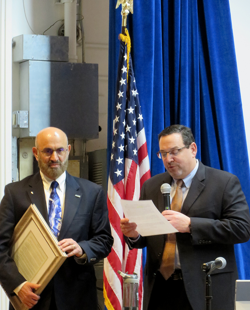 Dr. Ken Najjar (left) listens as DRBC Executive Director Steve Tambini reads the special resolution. Photo by DRBC.