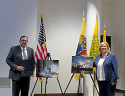 DRBC Exec. Dir. Steve Tambini and N.J.Assemblywoman Carol Murphy pose with the winning photos. Photo by DRBC.