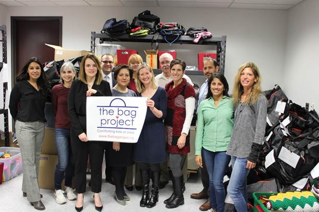 Education Commissioner Kimberley Harrington and NJDOE staff joined members of The Bag Project to help sort donated items into over 100 gift bags for children in need.