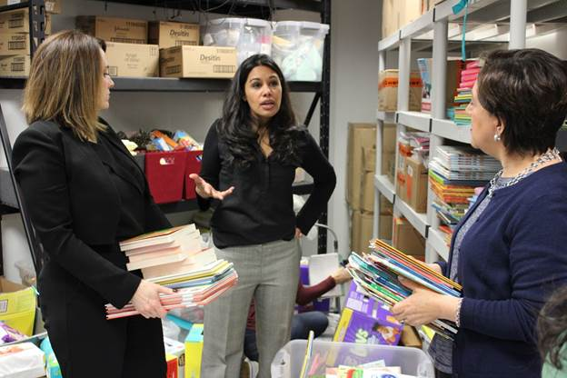 Anupa Wijaya, Executive Director of The Bag Project, explains to Education Commissioner Kimberley Harrington and NJDOE staff how donated books are provided to children across different age groups.