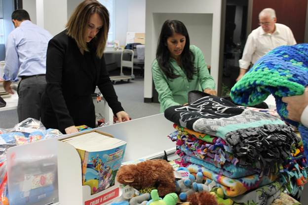 The bags for children include donated items such as a blanket, stuffed animal, coloring book and crayons, fullsizeshampoo and conditioner, children's toothpaste and soft toothbrush, and a comb set.