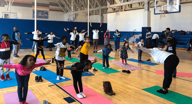Photo: Kids and adults doing yoga
