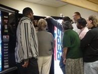 People surrounding a Vending Machine