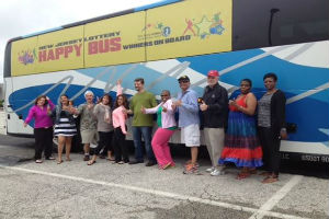 One group of winners getting ready to board the 'Happy Bus' to begin their day of filming the IGT Lottery's new 'Happy Dance' TV commercial.