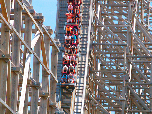 Riders take a steep plunge on one of the big wooden roller coasters at Six Flags Great Adventure, Jackson